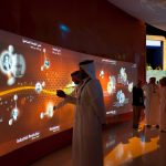 guests try out one of many interactive displays during the King Abdullah University of Science and Technology (KAUST) Inauguration Ceremony September 23, 2009 in Thuwal, Saudi Arabia (about 80 Kilometers north of Jeddah.) The University will act as a living laboratory by demonstrating that environmentally responsible methods of energy use, materials management, and water consumption are viable in the Middle East and across the globe. (Photo by Scott Nelson)